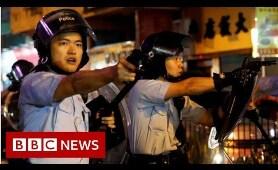 Hong Kong: What led to a single gunshot being fired? - BBC News